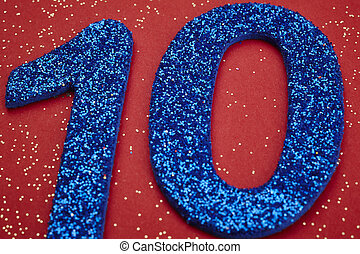 Number ten blue color over a red background. Anniversary....