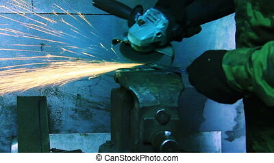Man Working With Angle Grinder.