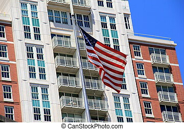 American flag and buildings