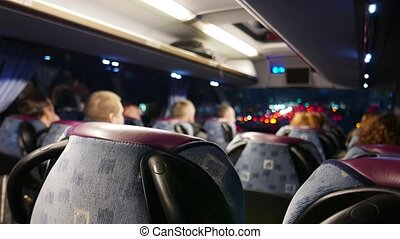 People riding in the bus