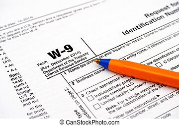 Form W-9 with ballpoint pen