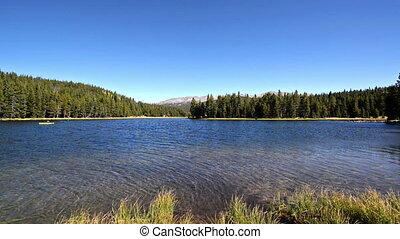West Ten Sleep Lake in Wyoming with kayakers visible to the...