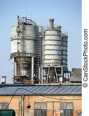 Silo - Old, abandoned industrial structure against clear...