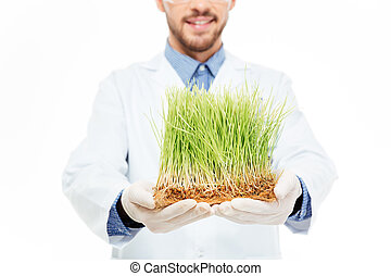 Male engineer showing a modified plants - Cropped imaage of...