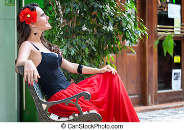 A spanish woman - A beautiful spanish woman relaxing on the...