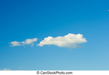 white fluffy clouds in the blue sky