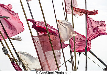 red and white flags in stormy weather