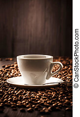 Cup of coffee on beans background - Cup fragrant coffee on...