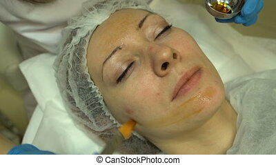 Cosmetic procedure for skin care - Application of the cream...