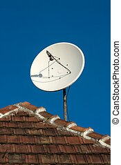 Parabola satellite receiver on a roof