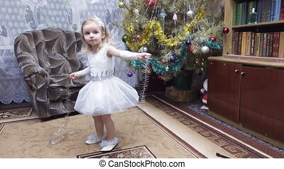 Girl in costume at Christmas tree - Next to Christmas tree...