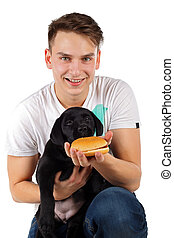 Cute labrador puppy - Picture of a man with his black...
