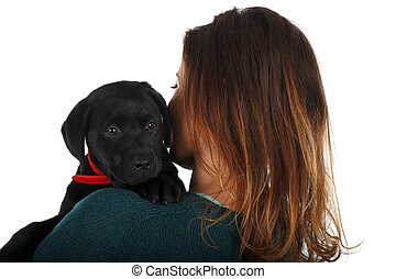 Black labrador puppy - Picture of a woman with her black...