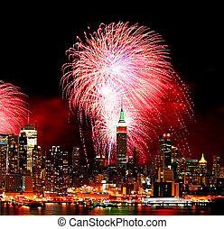 The New York City skyline and fireworks - The New York City...