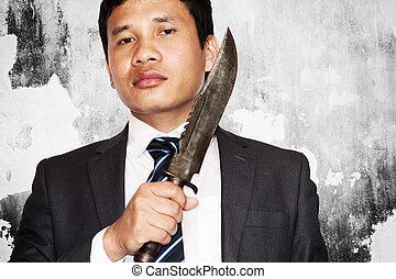 Business competition,Businessman bring out knife ready to...