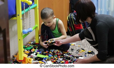 Child Boy and his Mother Playing with Toys