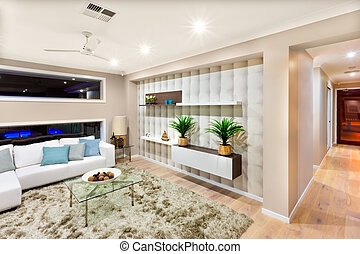 Living room interior in a luxurious house with lights on -...