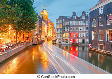 Canal in Amsterdam at night.
