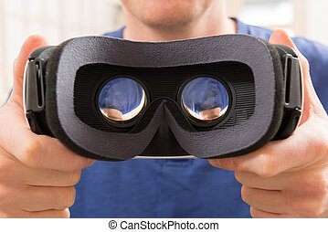 Virtual reality headset - Man using virtual reality headset...