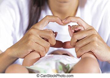 Hands of newborn baby