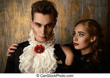 carnival - Beautiful couple of vampires dressed in medieval...