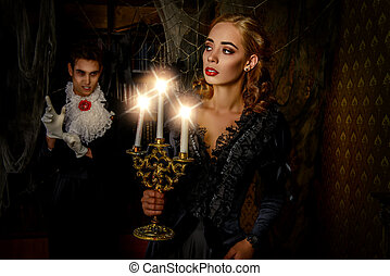 creeping up - Bloodthirsty male vampire in medieval dress is...