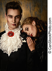 immortal - Beautiful couple of vampires dressed in medieval...