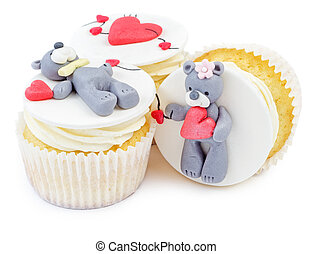 Cupcakes with teddy bear and hearts isolated