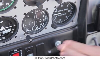 Instrument panel in the plane and the pilot's hand