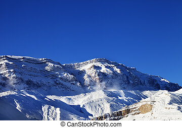 Snowy mountains at sun windy day Greater Caucasus, Mount...