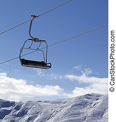 Chair lift and snowy mountains at nice day Caucasus...