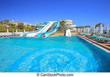 Water park - Outdoor water park slides at the resort in...
