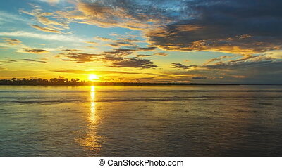 Amazon River Sunset - Sunset over the Amazon River seen near...