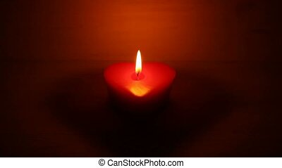 Candle heart shape - Candle burning in the night, heart...