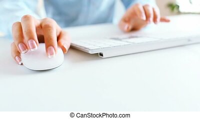 Woman typing on the keyboard - Woman office worker typing on...