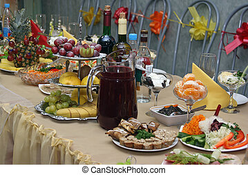 Festively covered table, with various dishes