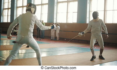 fencers on a training - Two man fencers on competition