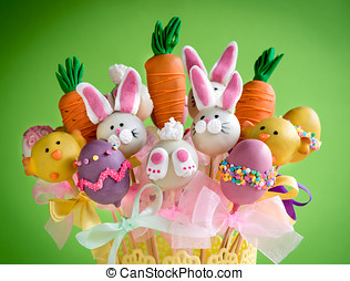 Cake pops time - Easter basket with cake pops on green...