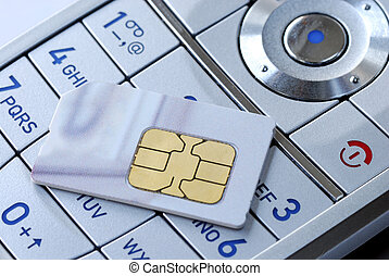 Close-up of the keypad and the sim card of a cellular phone