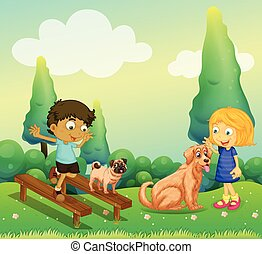 Boy and girl playing with dogs in the park