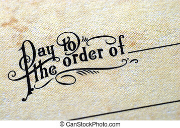 Close-up view of the phrase ldquo;Pay To The Order Ofrdquo;...