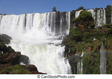 Iguassu waterfalls on a sunny day early in the morning. The biggest waterfalls on earth.