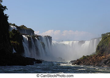 Iguassu waterfalls on a sunny day early in the morning The...