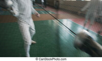 fencers on a training - Young man fencer on competition