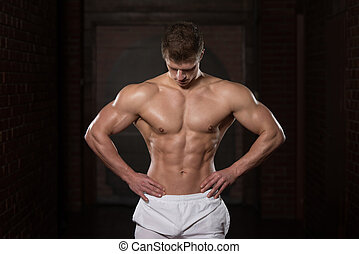 Portrait Of A Physically Fit Muscular Young Man - Portrait...