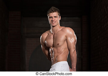 Healthy Young Man Showing His Well Trained Triceps -...