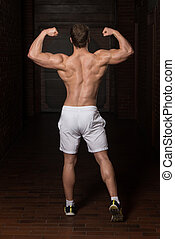 Physically Young Man Showing His Well Trained Back -...