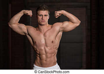Healthy Man Showing His Well Trained Biceps - Portrait Of A...