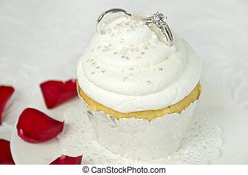 wedding rings in cupcake icing - Pair of wedding rings in...