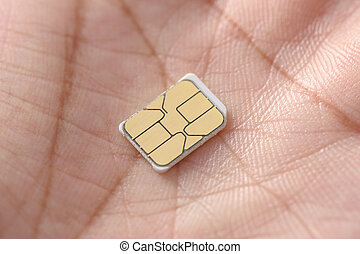 SIM card - closeup nano SIM card on human hand
